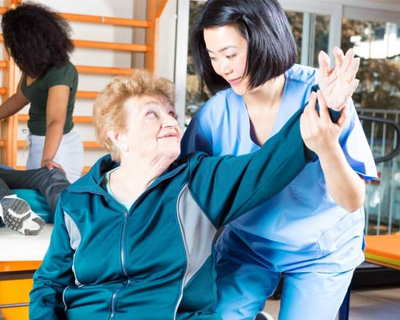 a senior woman doing physical therapy
