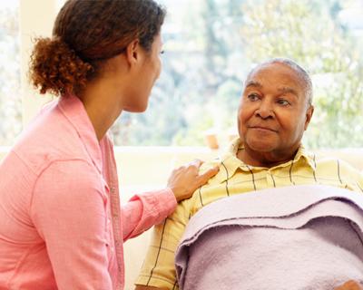 a caregiver taking care of a senior man