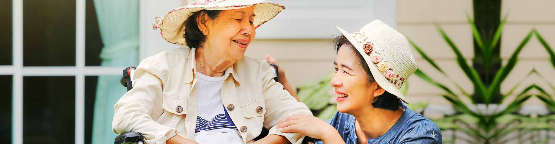 a caregiver and a senior woman smiling