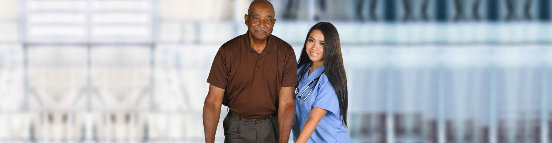 a nurse and a senior man smiling