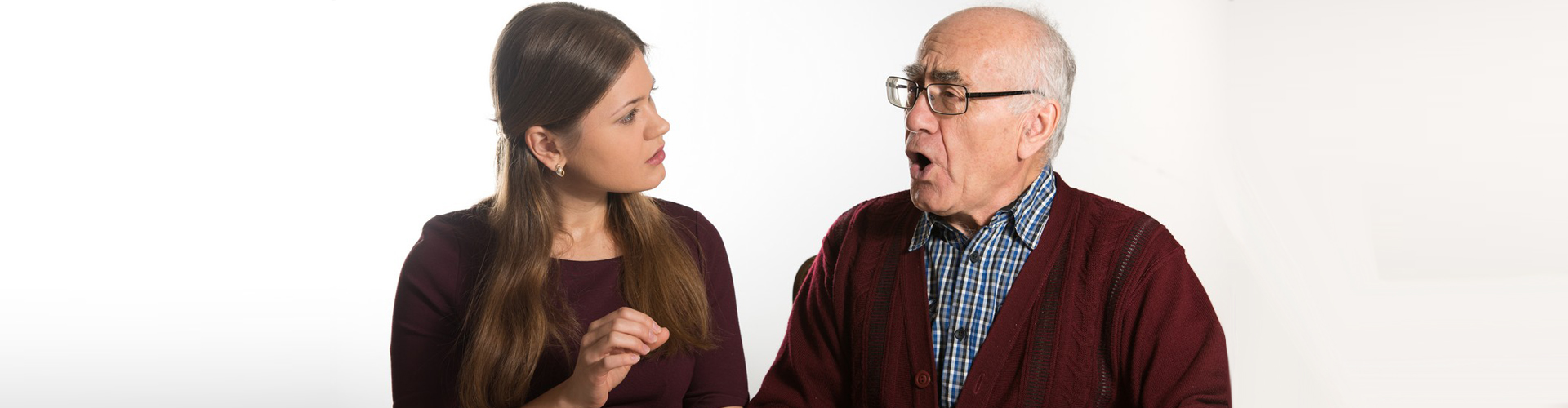 a therapist and a senior man doing speech therapy